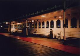 Nighttime photo of seating on Brighton Pier