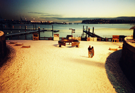 Photo of a snowy Cardiff Bay, looking across the Bay at sunset