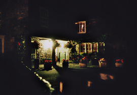 Nighttime photo of the front garden of house in Cartmel, Cumbria