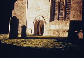 Nighttime photo of the exterior of Cartmel Priory, Cumbria