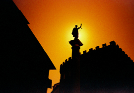 Photo of a statue in Firenze (Florence) taken against a burning red sky