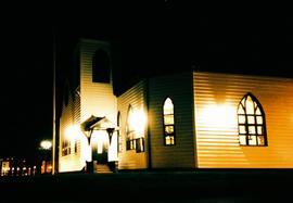 Nighttime photo taken at night of the Norwegian Church, Cardiff Bay