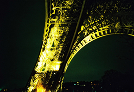 Close-up photo of the Eiffel Tower taken at night