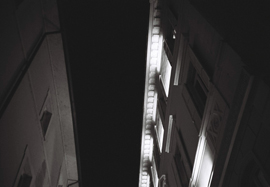 Nightime photo of a street in Rome