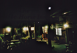Nighttime photo of the exterior of The White Horse pub, Rogate